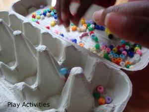 Setting up mancala, adding the 48 beads